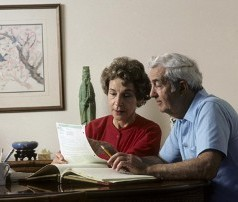 Senior Couple Reading Forms - Reverse Mortgage